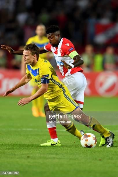 Crvena Zvezda's midfielder Mitchell Donald vies with Bate's forward Vitali Rodionov during the UEFA Europa League match between FK Crvena Zvezda...