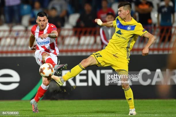 Crvena Zvezda's midfielder Nemanja Radonjic shoots the ball past Bate's midfielder Aleksei Rios during the UEFA Europa League match between FK Crvena...