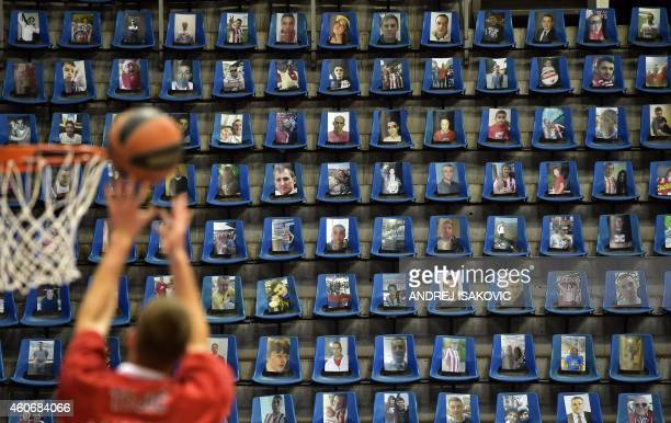 Crvena Zvezda's player warms up in front of empty seats with his team fans pictures ahead of the Euroleague basketball match between Crvena Zvezda...
