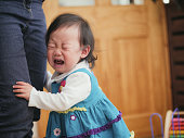 crying baby girl at home