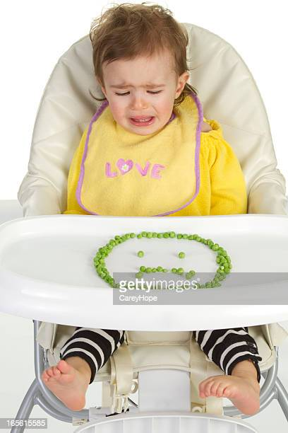 crying baby in high chair
