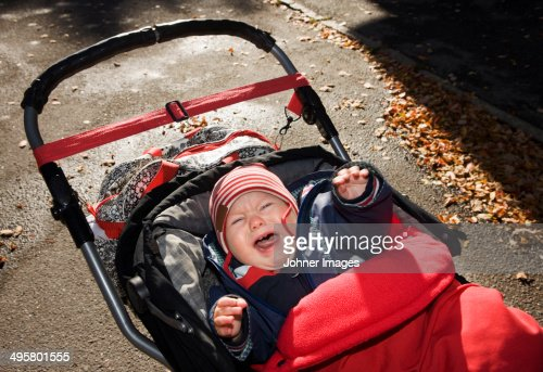 Crying baby in pram