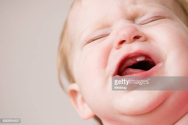 Crying Baby Suffering Through Pain of Teething