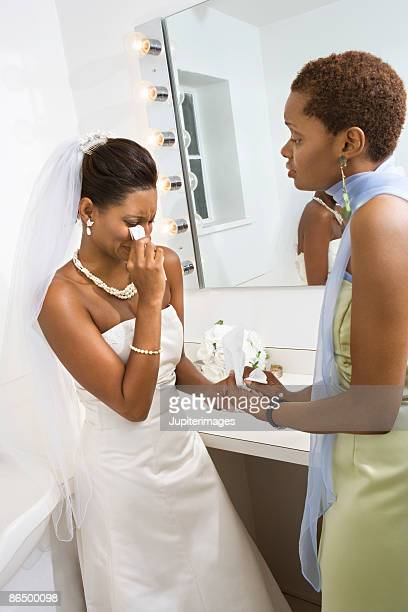 Crying bride with maid of honor