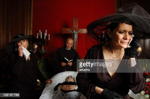 Crying Widow Dressed in Black at Catholic Funeral