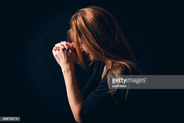 Crying Woman Saying Prayer