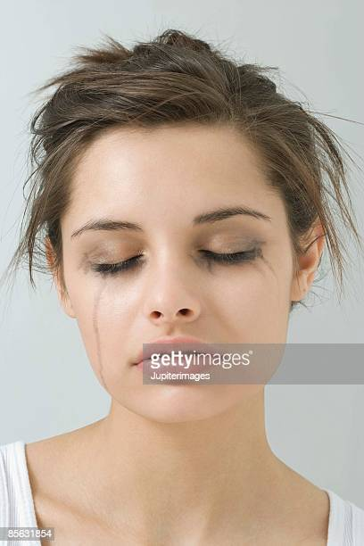 Crying woman with smeared mascara