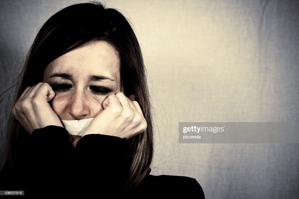 Crying Woman with Tape Covering Mouth : Stock Photo