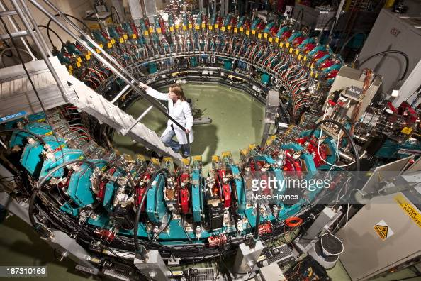 Cryogenics engineer Rachael Buckley is photographed inside the Electron Model of Many Applications accelerating ring which produces Thorium...