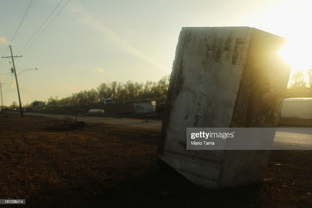 A crypt is flipped into the mud by Hurricane Isaac flooding in Plaquemines Parish on September 3, 2012 in Braithwaite, Louisiana. Damage totals from the storm could top $2 billion and more than 125,000 customers are still without power six days after the storm made landfall.