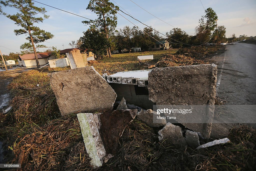 A crypt is shattered from Hurricane Isaac flooding in Plaquemines Parish on September 3, 2012 in Braithwaite, Louisiana. Damage totals from the hurricane could top $2 billion and more than 125,000 customers are still without power six days after the storm made landfall.