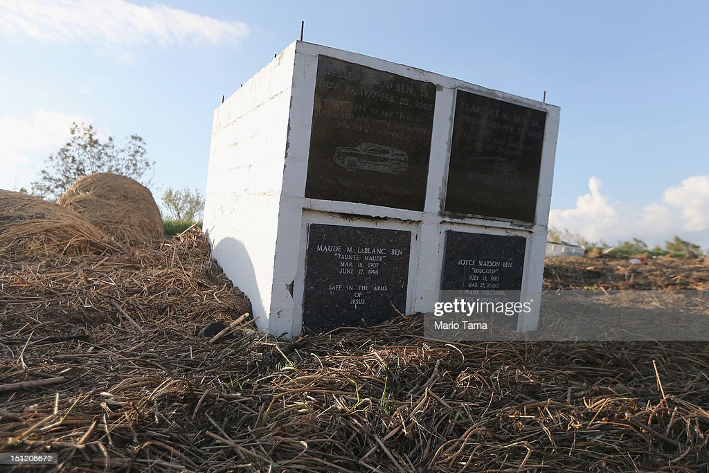 A crypt is washed up onto the side of a levee from Hurricane Isaac flooding in Plaquemines Parish on September 3, 2012 in Braithwaite, Louisiana. Damage totals from the storm could top $2 billion and more than 125,000 customers are still without power six days after the storm made landfall.
