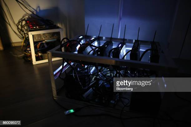 Cryptocurrency mining machines sit in operating racks at the home of Dmitry Gutov a Russian cryptocurrency 'miner' in Krasnogorsk Russia on Thursday...