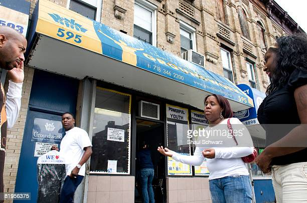 Crystal Alston and Candice Perkins staff workers of Groundwork Opportunity Program talk to people from their community in front of their office on...