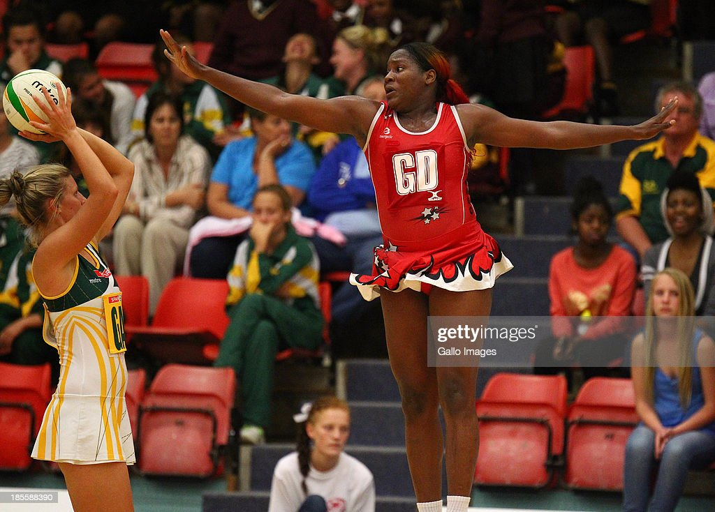 Crystal ann George of Trinidad and Tobago jumps and tries to stop Maryka Holtzhausen of South Africa during the International Tri Nations match between South Africa and Trinidad and Tobago at Vodacom NMMU Indoor Stadium on October 22, 2013 in Port Elizabeth, South Africa.