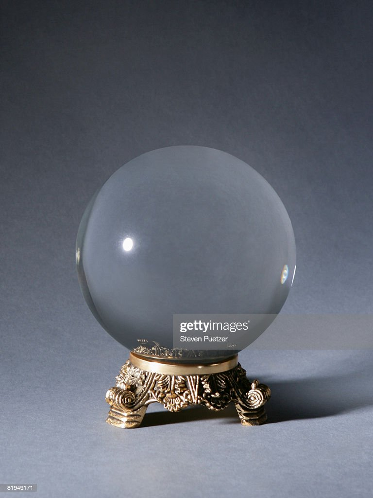 Crystal ball against gray background
