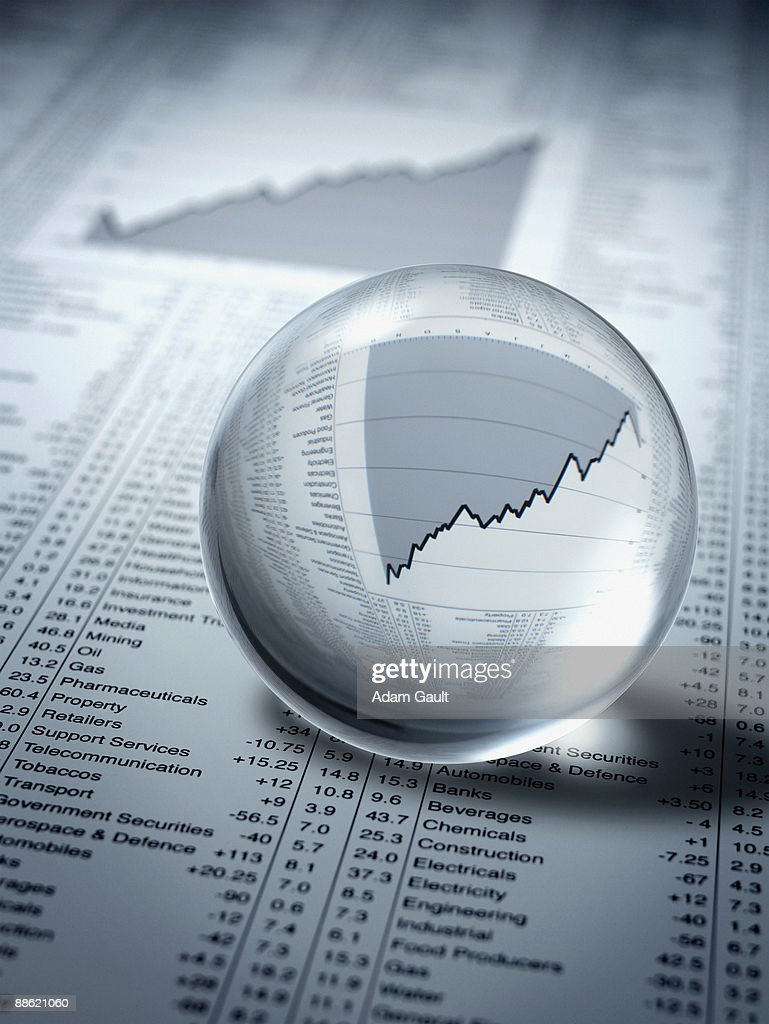 Crystal ball, ascending line graph and share prices : Stock Photo