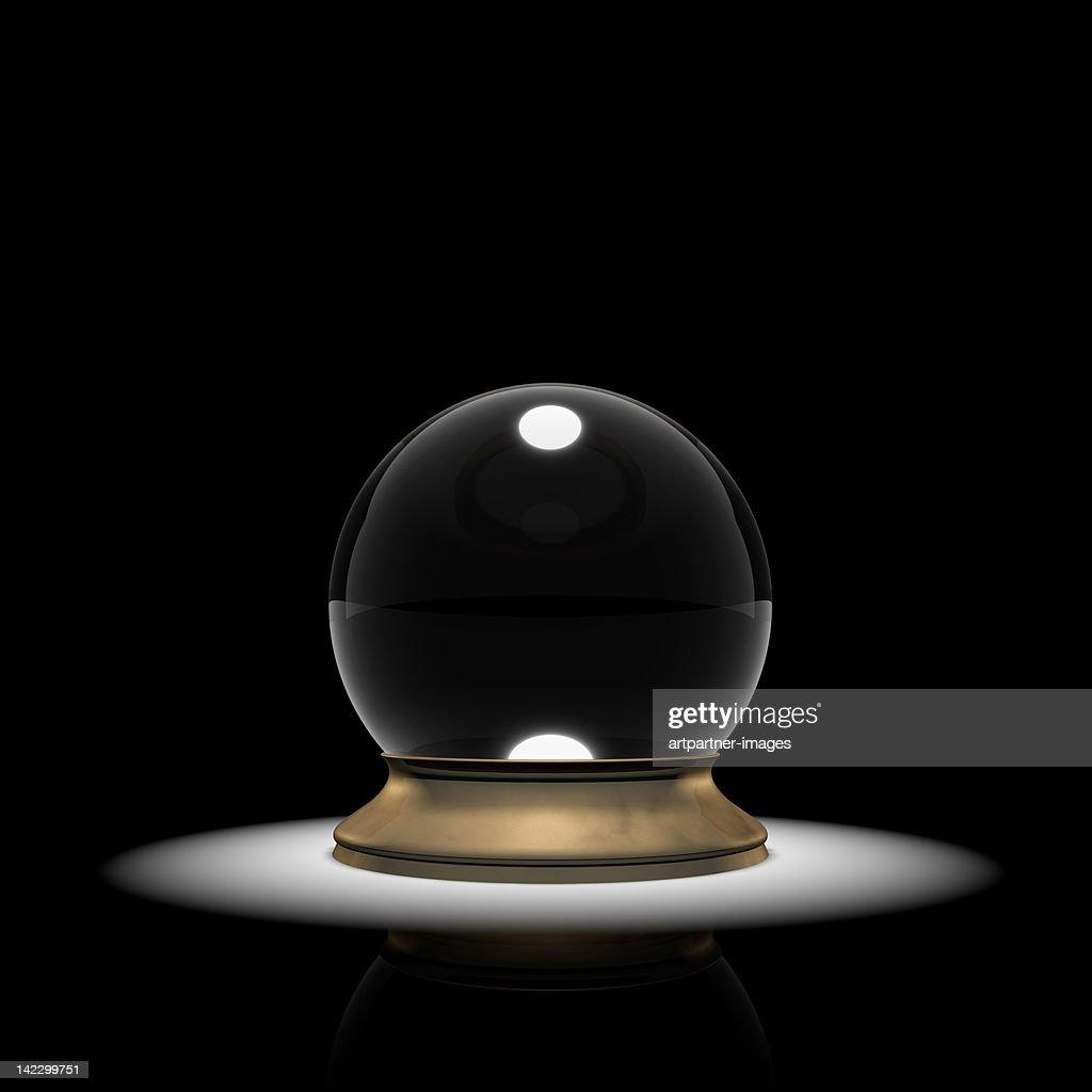 Crystal ball in a spotlight
