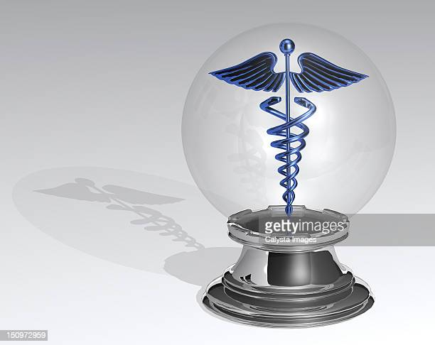 Crystal ball with Caduceus inside