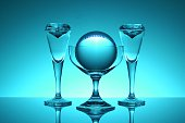 Crystal Balls In Glass Against Blue Background