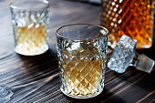Crystal Decanter. Crystal glasses. Brandy, cognac whiskey with ice closeup