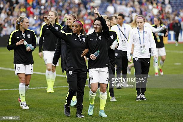 Crystal Dunn and Meghan Klingenberg of the United States wave to fans after the United States defeated Ireland 50 at Qualcomm Stadium on January 23...