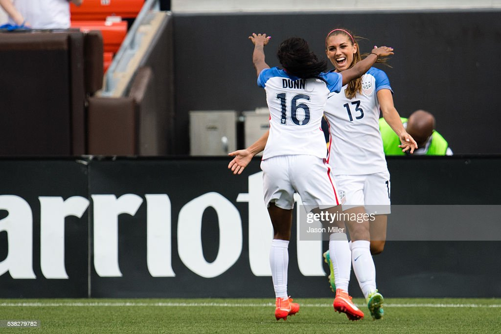 Crystal Dunn celebrates with Alex Morgan after Morgan of the US Women's National Team scored with an assist by Dunn during the second half of a...