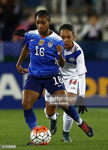 Crystal Dunn dribbles the ball against Ashley Rivera of Puerto Rico during CONCACAF Women's Olympic Qualifying at Toyota Stadium on February 15 2016...