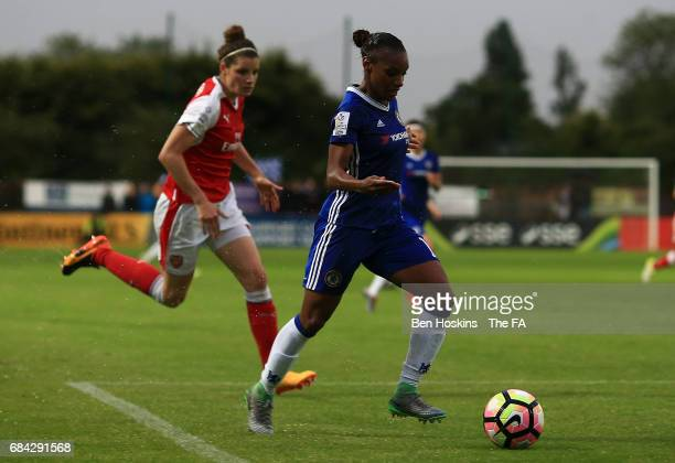 Crystal Dunn of Chelsea advances under pressure from Dominique Janssen of Arsenal during the WSL 1 match between Chelsea Ladies and Arsenal Ladies on...
