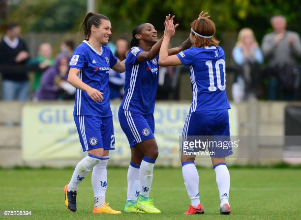 Crystal Dunn of Chelsea celebrates with team mate Ramon Bachmann and Ji So Yun after scoring to make it 50 during the FA WSL 1 match between Chelsea...