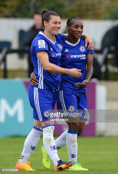 Crystal Dunn of Chelsea celebrates with team mate Ramon Bachmann after scoring to make it 50 during the FA WSL 1 match between Chelsea Ladies and...