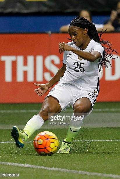 Crystal Dunn of the United States advances the ball against Trinidad Tobago during an international friendly match at the Alamodome on December 10...
