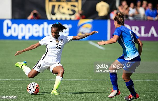 Crystal Dunn of the United States attempts a shot against Tamires of Brazil during a Women's International Friendly soccer match between Brazil and...