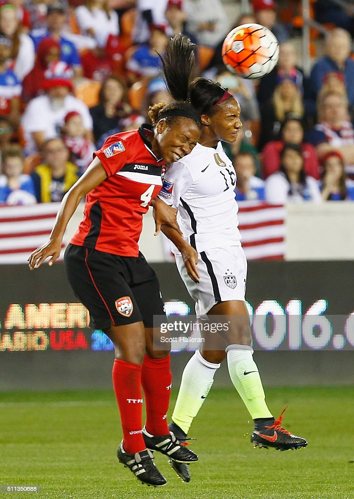 Crystal Dunn #16 of the United States battles for the ball with Danielle Blair #4 of Trinidad and Tobago during their Semifinal of the 2016 CONCACAF Women's Olympic Qualifying at BBVA Compass Stadium on February 19, 2016 in Houston, Texas.