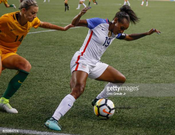 Crystal Dunn of the United States dribbles against Alanna Kennedy of Australia during the 2017 Tournament of Nations at CenturyLink Field on July 27...