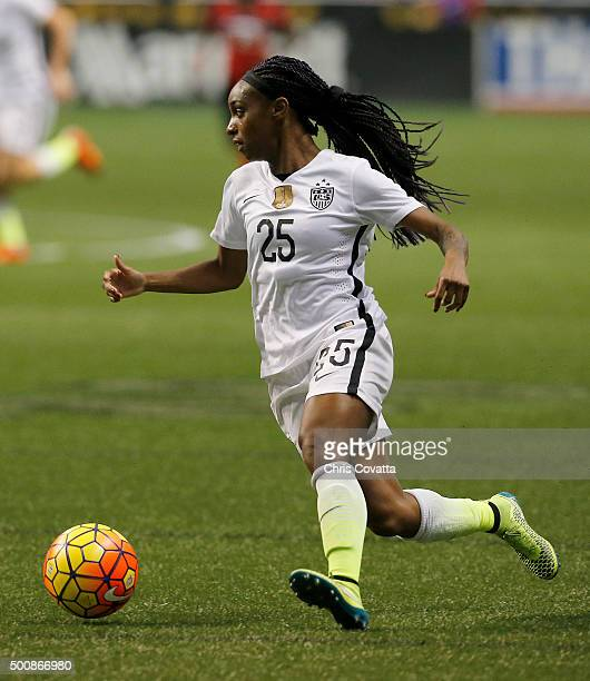 Crystal Dunn of the United States dribbles the ball against Trinidad Tobago during an international friendly match at the Alamodome on December 10...