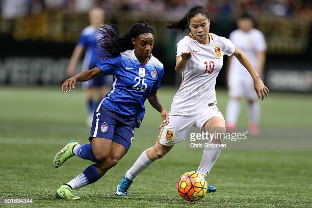 Crystal Dunn of the United States drives the ball past Tan Ruyin of China at MercedesBenz Superdome on December 16 2015 in New Orleans Louisiana