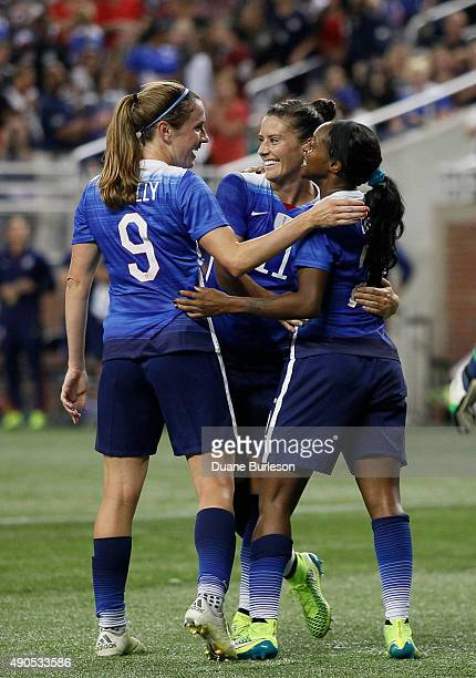 Crystal Dunn of the United States is congratulated by Ali Krieger of the United States and Heather O'Reilly of the United States following a goal...
