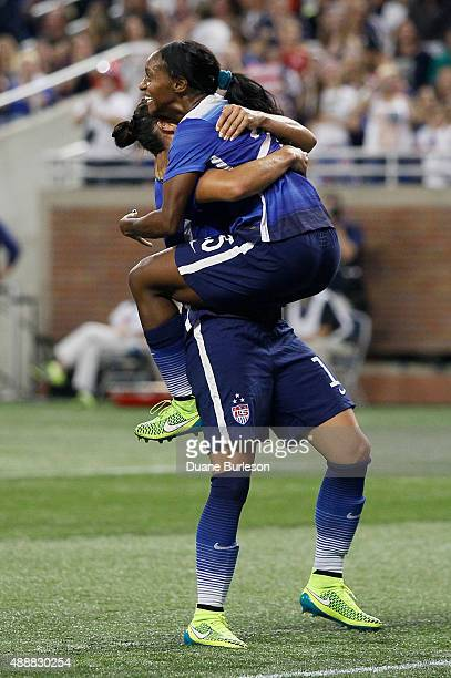 Crystal Dunn of the United States jumps into the arms of Ali Krieger of the United States after scoring a goal against Haiti during the second half...