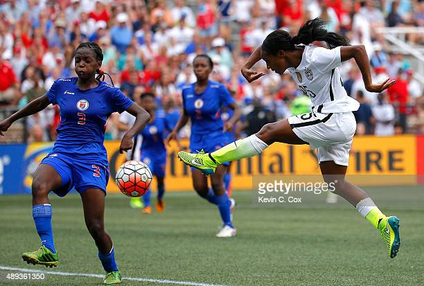 Crystal Dunn of the United States of America takes a shot against Jennifer Limage of Haiti during the US Women's 2015 World Cup victory tour match at...