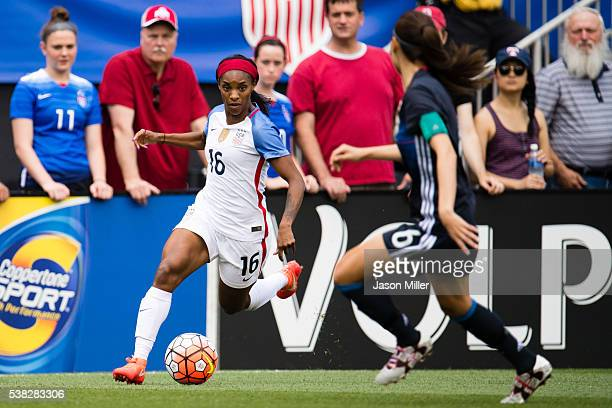 Crystal Dunn of the US Women's National Team controls the ball while under pressure from Rumi Utsugi of Japan during a friendly match on June 5 2016...