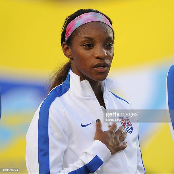 Crystal Dunn of the US women's national team stands at attention during the National Anthem prior to their match against the Swiss women's national...