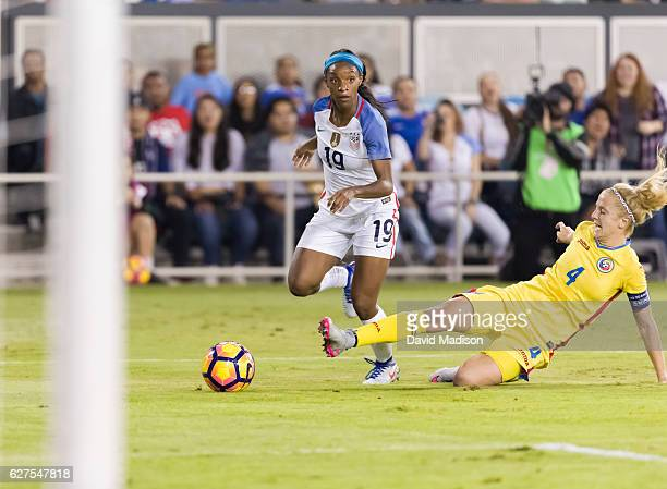 Crystal Dunn of the USA plays in a soccer game against Romania on November 10 2016 at Avaya Stadium in San Jose California Defending is Ioana Bortan...