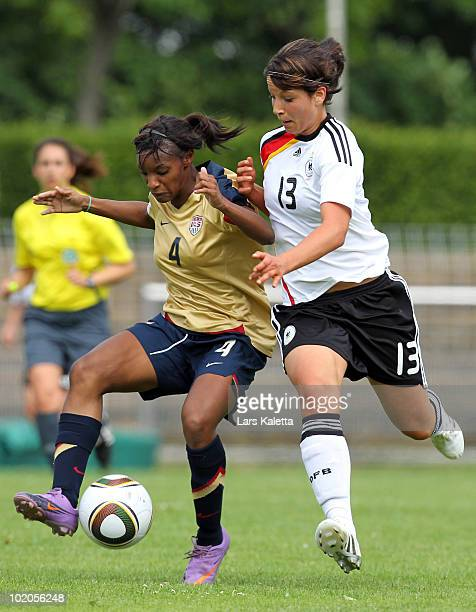 Crystal Dunn of USA challenges Sylvia Arnold of Germany during the DFB women's U20 match between Germany and USA at the LudwigJahnStadion on June 13...