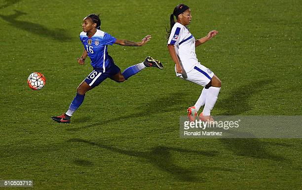 Crystal Dunn of USA dribbles the ball past Kelley Johnson of Puerto Rico during CONCACAF Women's Olympic Qualifying at Toyota Stadium on February 15...