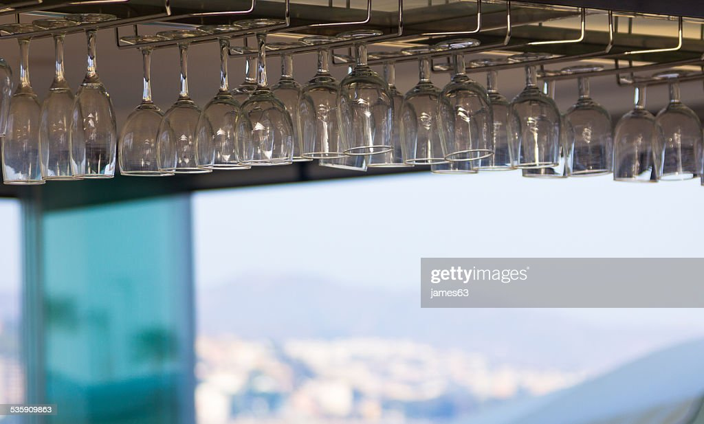 crystal glasses adorning the roof of a cafe : Stock Photo