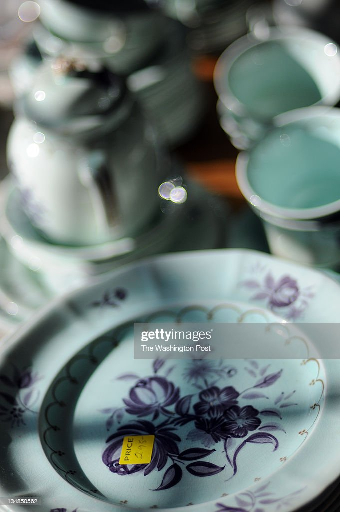 C., DECEMBER 3, 2011. Crystal glasses, china, and fine silver are placed on the dining room table during an estate sale at the home of the late Supreme Court Justice Potter Stewart. Sixty year accumulation of antique furniture, china, silver, antique bric a brac, historic objects, leather goods, Presidential and Supreme Court Memorabilia are offered inside the 6 bedroom, 3 story house.