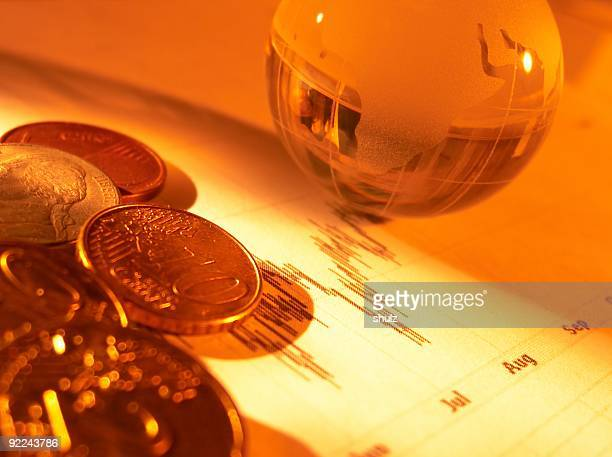 Crystal globe and coins on the stock page
