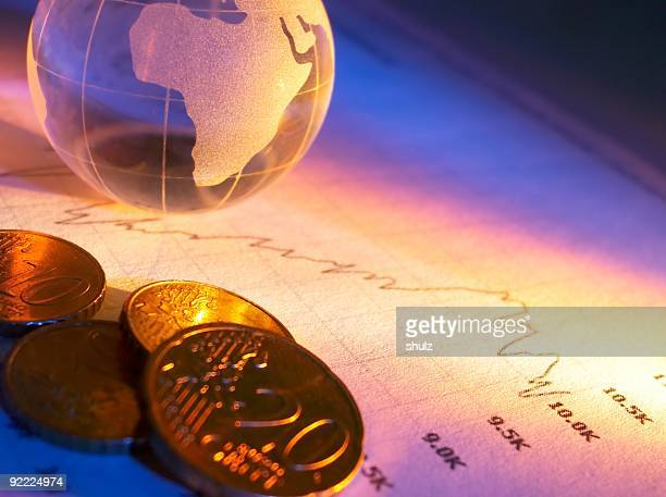Crystal globe coins and stock chart