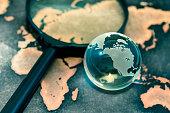 Crystal globe on grunge world map